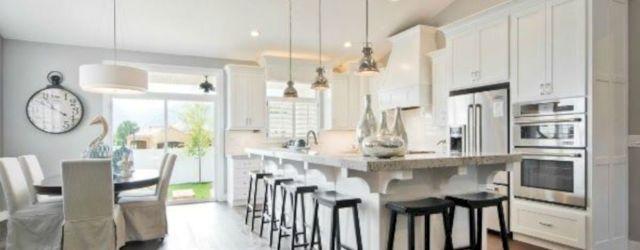 Cozy white kitchen with dark floors 39