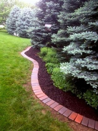 Elegant backyard landscaping ideas using bricks 32