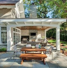 Romantic rustic outdoor kitchen designs with fireplace 21