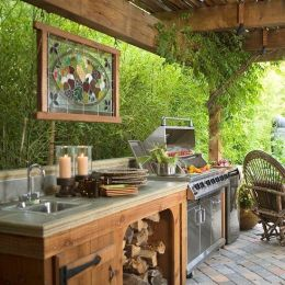 Romantic rustic outdoor kitchen designs with fireplace 26