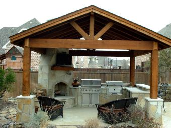 Romantic rustic outdoor kitchen designs with fireplace 33