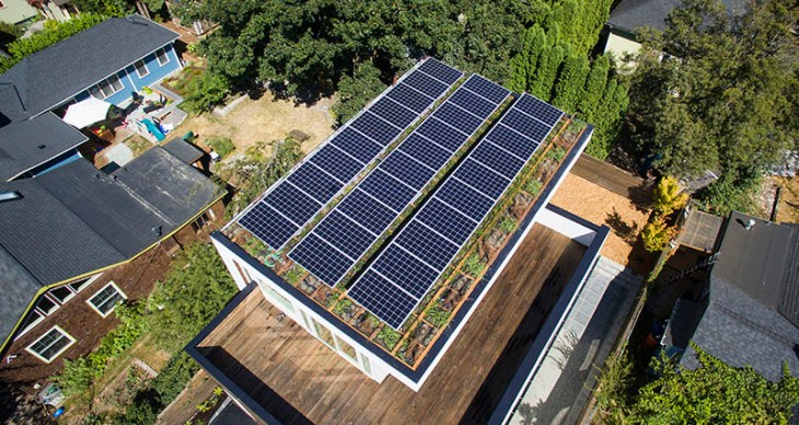 A Tremendous Contemporary House That Features A Green Roof And Solar Panels 9