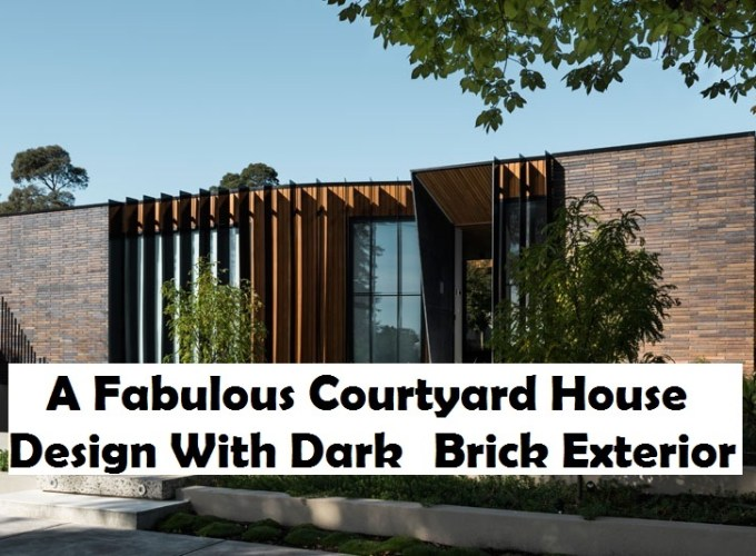 A fabulous courtyard house design with dark brick exterior