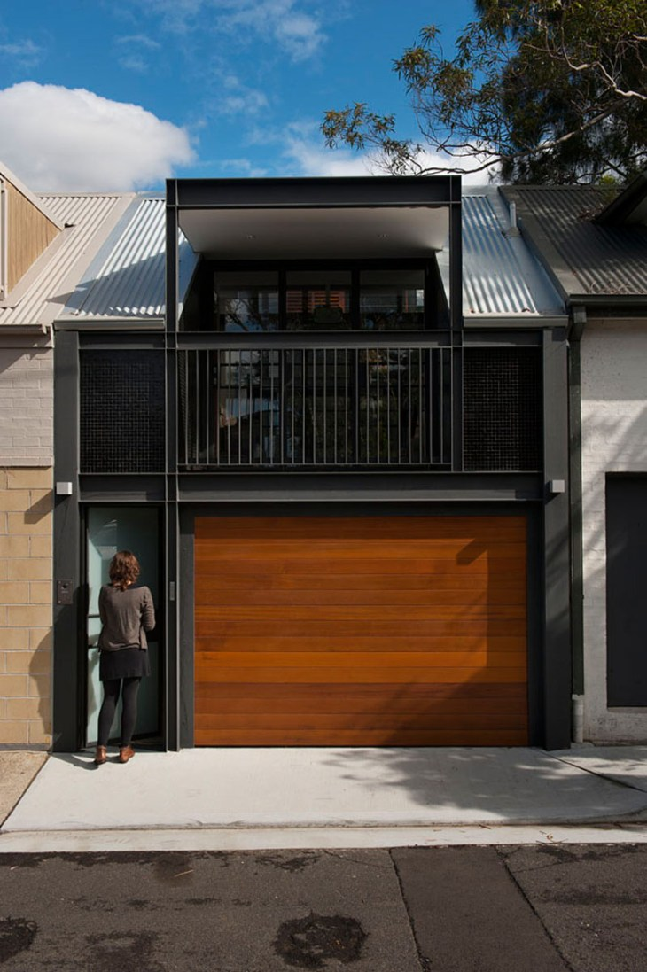 A-stunning-terrace-house-with-bold-black-and-wood-exterior-1