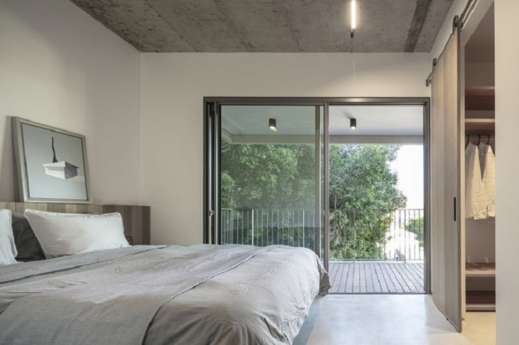 Comfy apartment design with a wooden box for a young family with kids 6