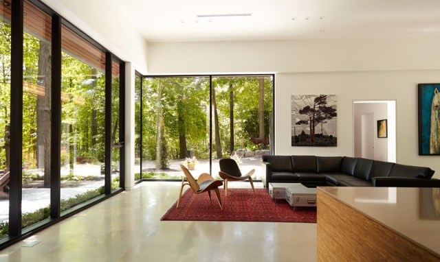 Contemporary home in the forest featuring dark brick exterior 5