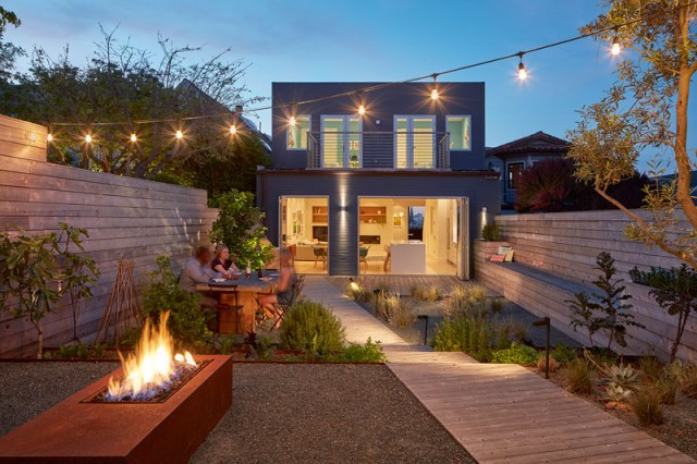 Contemporary house with a top floor and outdoor covered in wood to create an urban oasis 1