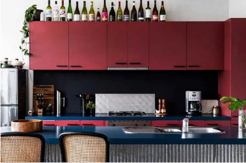 Industrial apartment design with burgundy kitchen that anyone wishes to stay 3