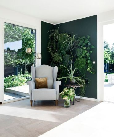 10-an-awkward-nook-with-a-living-wall-a-comfy-chair-and-a-table-lots-of-greenery-it-looks-very-inspiring-and-refreshing
