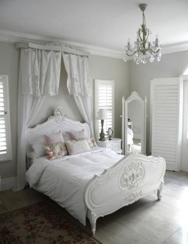 14-serene-all-white-space-with-a-refined-bed-and-a-vintage-floor-mirror