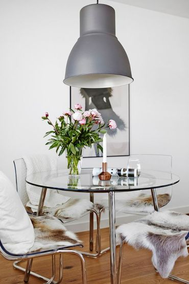 22-a-chic-modern-round-dining-table-with-a-steel-framing-and-a-glass-tabletop-looks-cool-and-glam