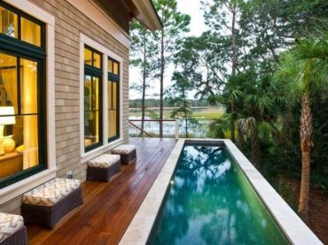22-a-wooden-deck-along-the-house-side-with-ottomans-and-a-long-narrow-pool