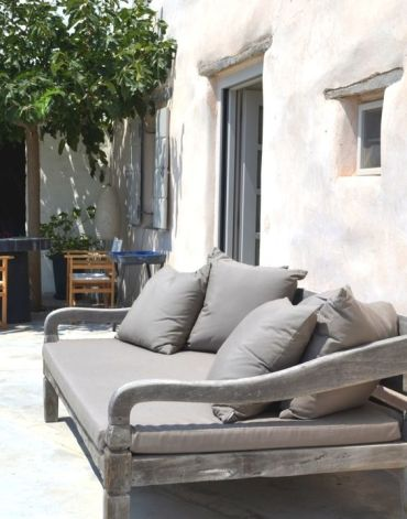 14-a-weathered-wood-sofa-with-grey-cushions-and-pillows-and-a-refined-vintage-design