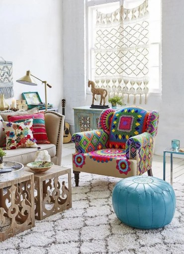 Elegant-boho-chic-living-room-with-leather-ottoman-armchair-coffee-tables