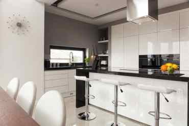 Open-layout-black-and-white-kitchen-2