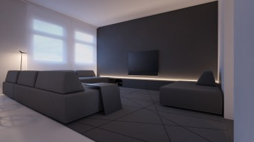 White-and-grey-living-room-geometric-carpet-grey-couches-tv-floor-lamp