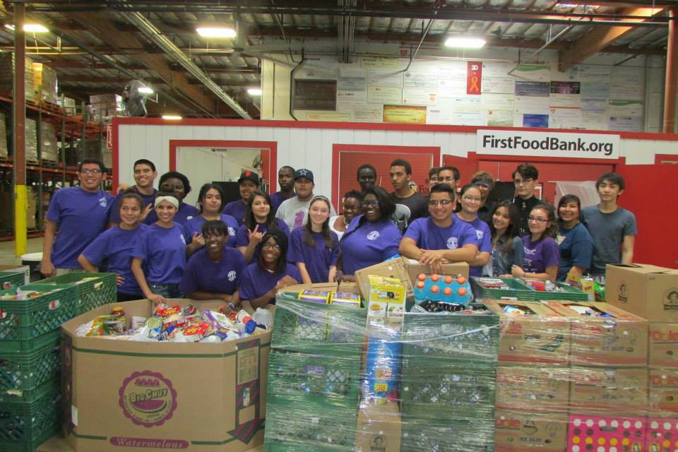 Washington High School Interactors helping out at St. Mary's Food Bank where they sorted 14,621 pounds of food in  2hrs.