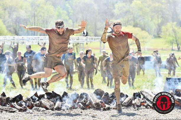 My buddy Justin and I jumping the fire at the finish line!