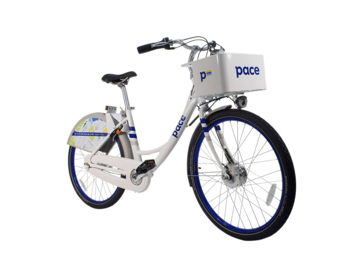 A white bicycle with black tires and fenders floats against a white backdrop.