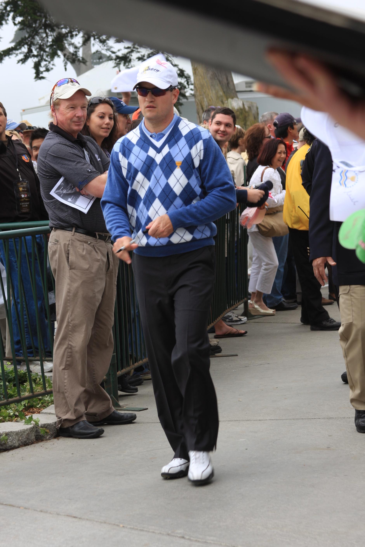 Zach Johnson, PGA Tour Pro, sports pink ribbon at President's Cup