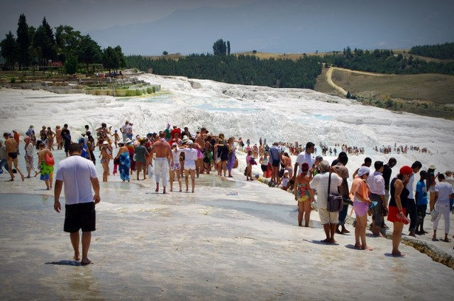 Huh...if you don't get up early, you might get some company later on in exploring Pamukkale...Too much, heh