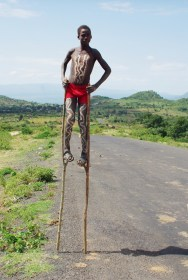 walking on stilts - kids do everything to pay tourists attention