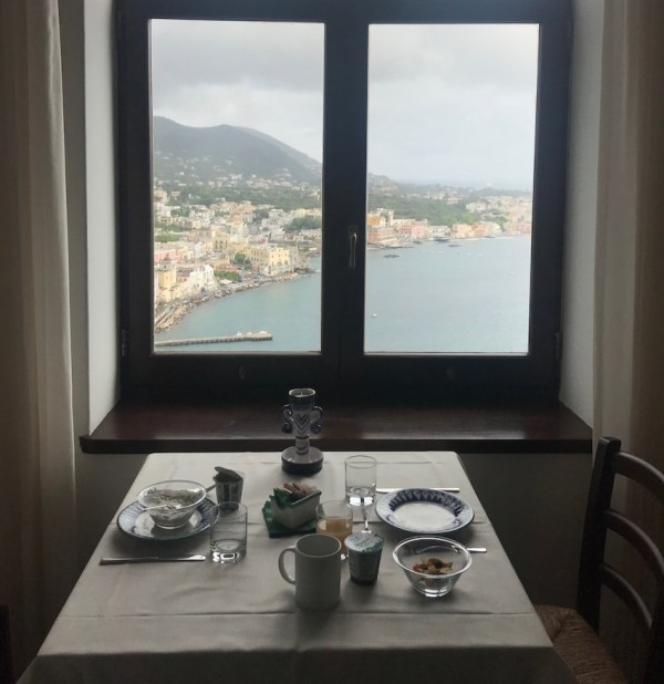 View of Ischia Ponte through the window of the cafe at Castello Aragonese