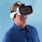 photograph of a man in a blue shirt wearing virtual reality headset