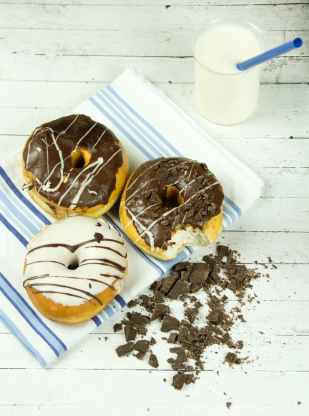 three assorted donuts with milk