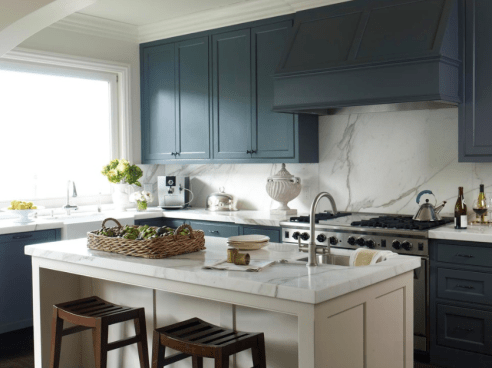 Deep Blue Cabinets With White Island