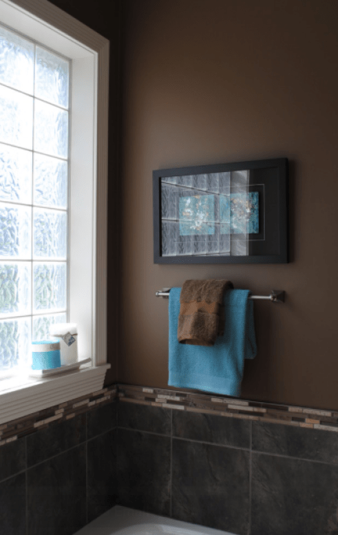 Modern Brown Bath With Blue Accents