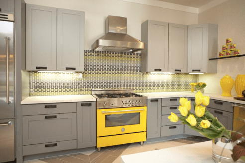 Flowers are a great way to add a pop of colour without a lot of commitment. If you WANT to make a commitment try appliances in a funky colour like this stove.