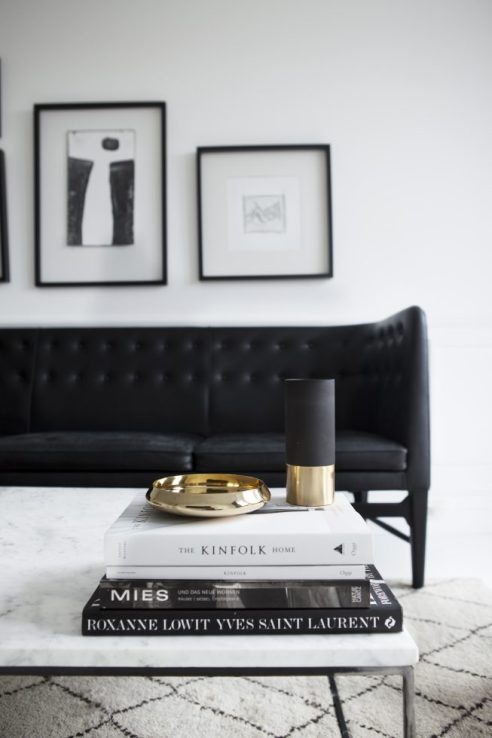 If you prefer your spaces clean and modern try a colour scheme with strong contrast like this black and white stunner. Add gold for warmth.