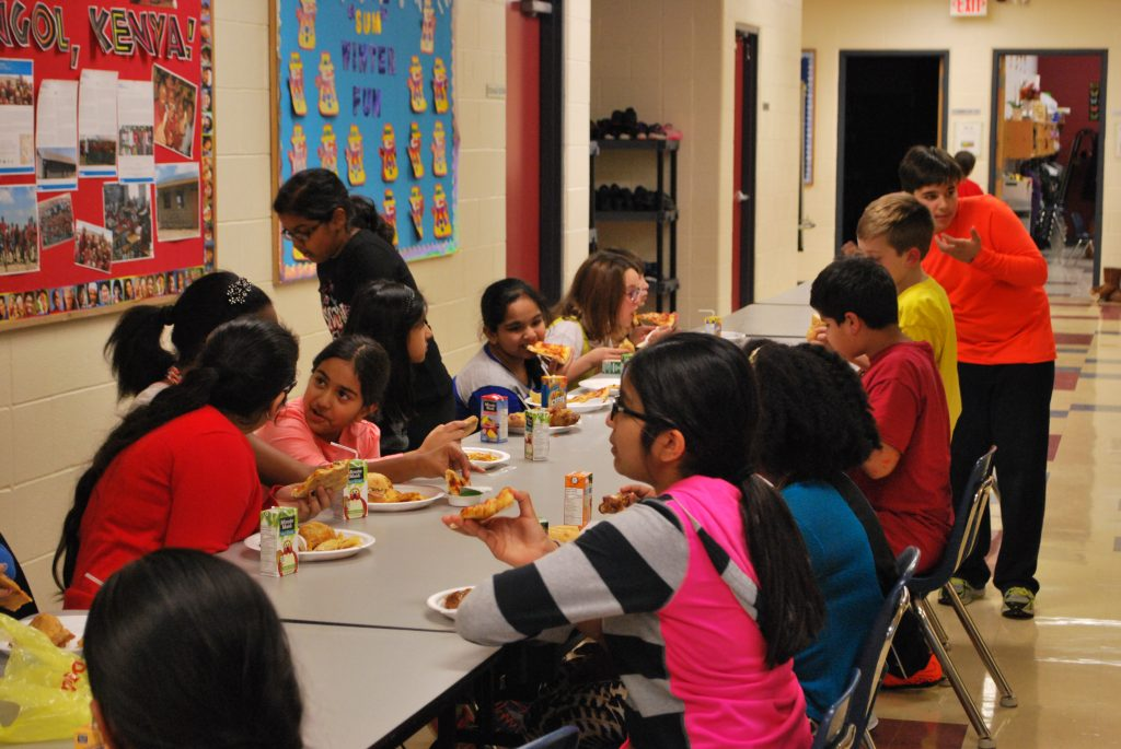 Students dining together at the Grade 5 & 6 Sleep over in preparation for camp