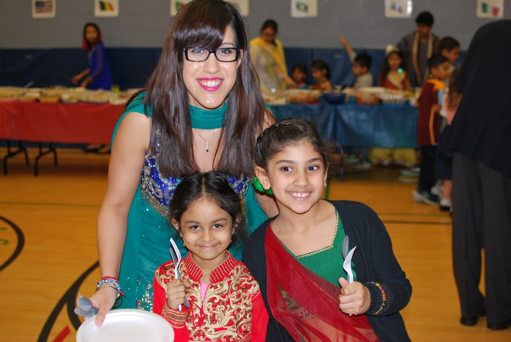 Students and teachers enjoying the international day pot luck lunch