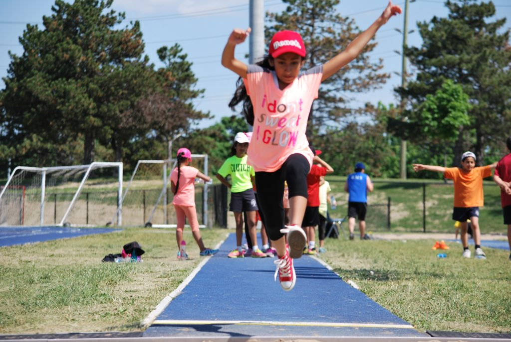 Giving everything they have at the long jump pit