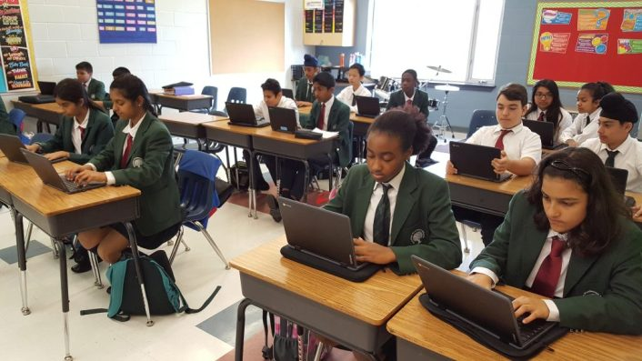 Grade 7 students at Rowntree Montessori Schools in class on their computers