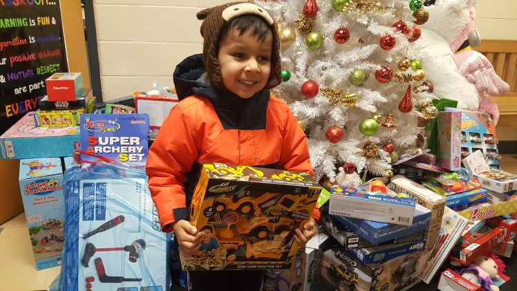 Student from RMS Private School donating a toy to Toys for Toys Peel Campaign