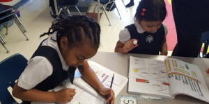 RMS private school children working at their desks