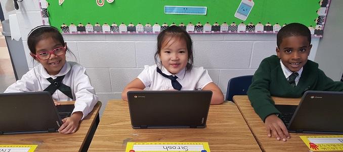 Students working on Google chromebooks in Grade 1 at Rowntree Montessori Schools in Brampton
