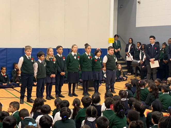 Remembrance Day 2018 at Rowntree Montessori Schools - students reciting a poem