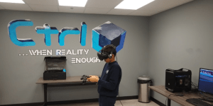 Grade 5 student at virtual reality arcade in Brampton during RMS private school field trip