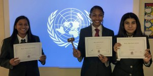 Students showcasing their awards from the 2019 Model United Nations Conference