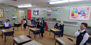 Grade 1 students using sign language in wellness time