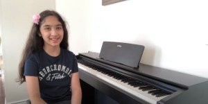 A grade 6 student playing the keyboard