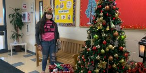 A student on our Annual Mitten Tree Day