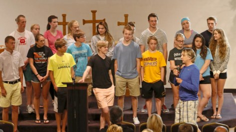 Kurt Janssen, front right, talks to the youth who will be going to San Diego, Calif. on a mission trip during a Wednesday night church service at The Lutheran Church of Christ the King in Moorhead, Minn. Carrie Snyder / The Forum