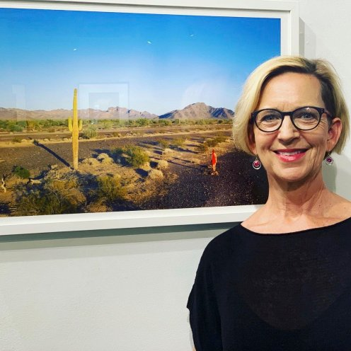 Roxanne Darling, photographer, with her piece, Discussing Age at Sunset with a Saguaro