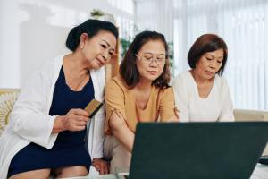 Senior women shopping online