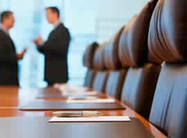 image of business persons doing one on one discussion in conference room